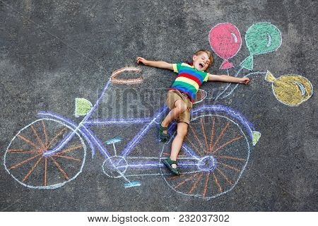 Happy Little Kid Boy Having Fun With Bicycle And Air Balloons Picture Drawing With Colorful Chalks O
