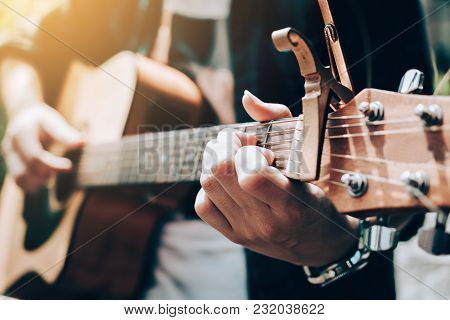 Asian Man Playing Guitar And Catch Chord.
