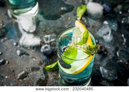 Summer Refreshment Drinks, Blueberry Lemonade Or Mojito Cocktail With Lemon, Fresh Blueberries And M