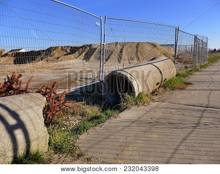 Construction Site With Seweragepipes For Building Houses Surrounded With Fencing