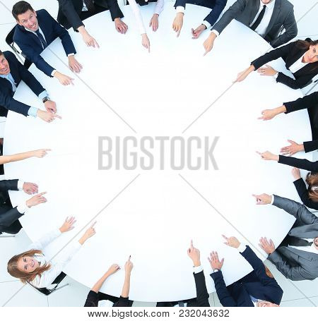 group of business people sitting at the round table. the business concept