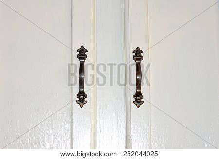 Symmetrical White Wood Cabinet Panel With Handles Background