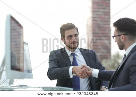 two young bearded men, handshake and smiling during the meeting