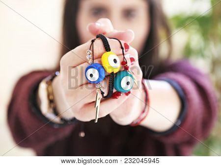 Woman Holding Evil Eye Bracelets - Greek Jewelry Advertisement - Fashion Accessories