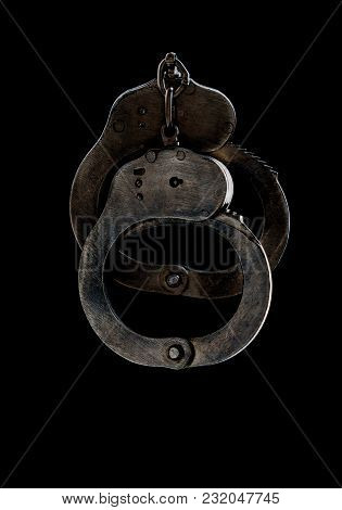 Steel Handcuffs Of Police Special Equipment, Fetters On A Black Background