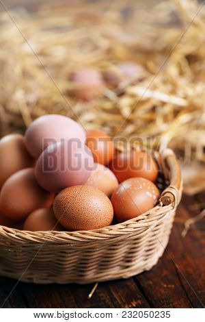 Easter Eggs In Basket On A Wooden Background