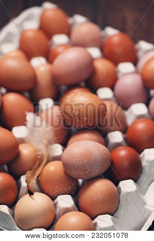 Brown Eggs In Tray On Wooden Background, Top View