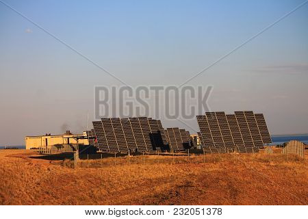 Power Plant From Batteries Of Solar Cells On The Shore Of Kapchagai Lake In Kazakhstan.