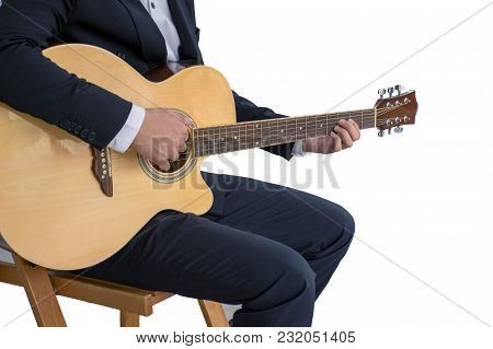 Close Up Of Man Wearing Formals Playing Acoustic Guitar Isolated On White Background