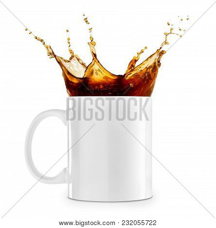 Spilling Coffee In Cup Isolated On White Background. Coffee Splash
