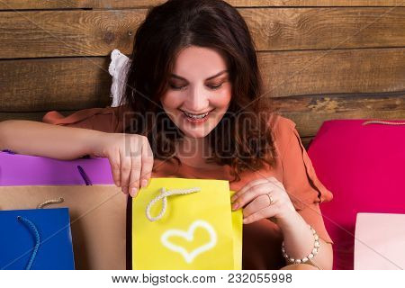 Happy Woman After Shopping With Versicolored Paper Bags On Bed