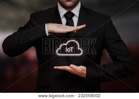 Internet Of Things Concept Text Between Hands Of The Businessman, Blurry Bokeh Background