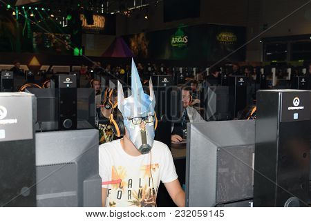 Cologne, Germany - August 24, 2017: Trade Fair Visitor With Mask Play With Others The Game Overwatch