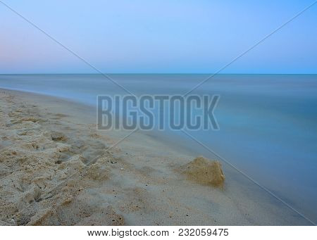 Charming Landscape On The Shores Of The Black Sea With Blurred Water On The Background Of The Sky