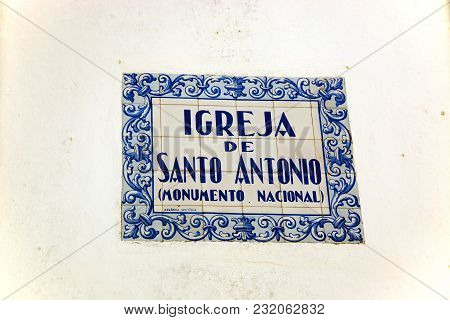 Lagos, Portugal - June 9, 2017 - Ceramic Sign For The Santo Antonio Church Written In Portuguese On