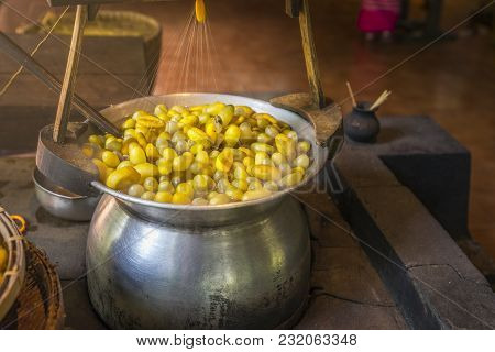Boiling Yellow Silkworm Cocoons To Make Silk Thread. Boiled Yellow Silk Nest To Make Silk Thread.