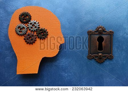 Gears And Paper Head Cutout With Lock, On Blue Textured Background - Problem Solving Concept