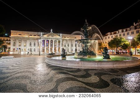 Lisbon, Portugal - January 26, 2011: Rossio Square At Night, Baixa District, Lisbon, Portugal