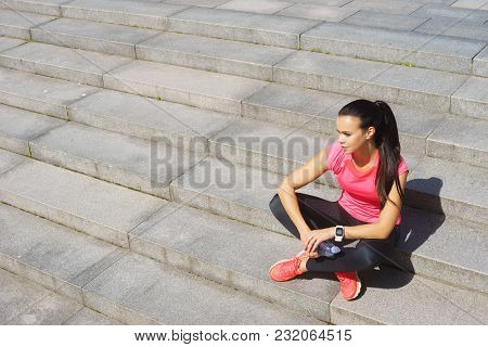 Young, Fit And Sporty Girl Resting After The Training. Sport, Fitness And Healthy Lifestyle Concept.