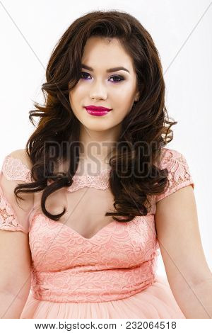 Portrait With Makeup And Hairstyle With A Beautiful Young Brunette