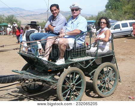 Alora, Spain - September 11, 2011: People In Buggy At Local Fiesta In Andalusia