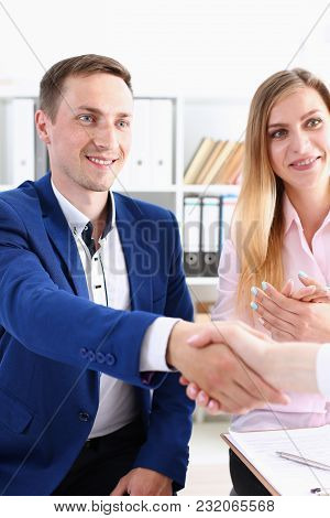 Smiling Man And Woman Shake Hands As Hello In Office Portrait. Friend Welcome Mediation Offer Positi