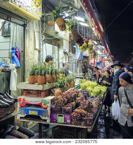 Jerusalem, Israel, September 10, 2015 :  Buyers Buy Fruit In An Open Shop In Mahane Yehuda Market In