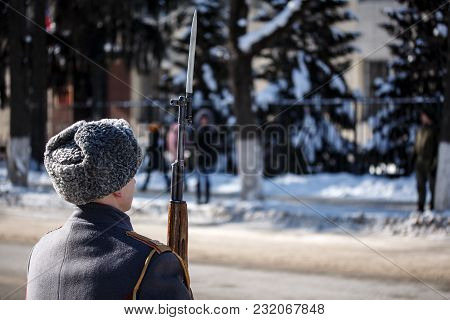 Winter. Guard Of Honour. Soldier Hold Carbine With Bayonet