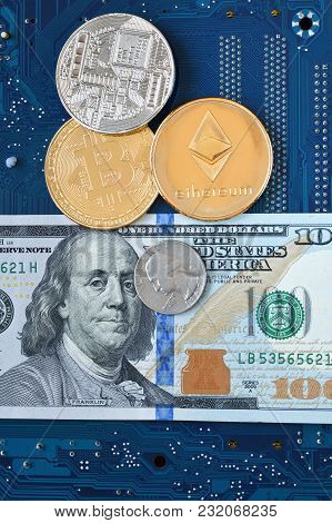 Coins Of Cryptocurrency Ethereum, Bitcoin, Dollar Banknote And A Quarter Of A Dollar On The Blue Com