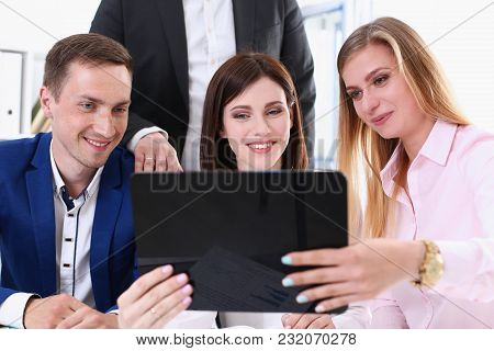 Group Of People In Office Look At Mobile Tablet Pc. Funny Internet Video White Collar Colleague Shar
