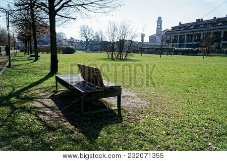 Art Bench In Public Park, Loneliness At Clear Sunny Spring Day.