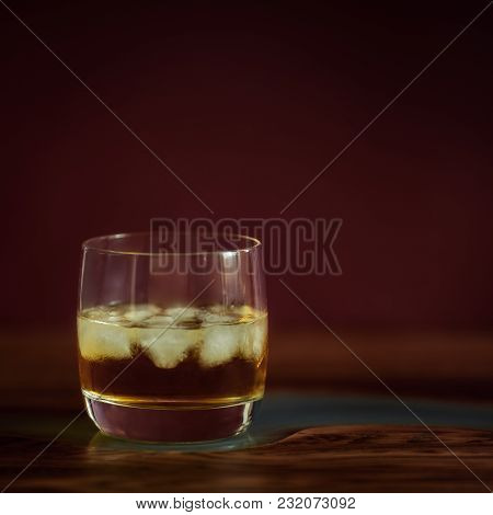 Alcohol Drinks (whisky) On Dark Solid Red Background