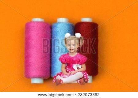 A Little Child In The World Of Big Things. The Girl In The Red Dress Sits About Three Huge Coils Wit