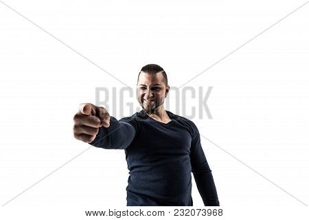 Charming Athletic Guy Bodybuilder In Jeans And A T-shirt Pointing Forward.the Photo Has A Empty Spac