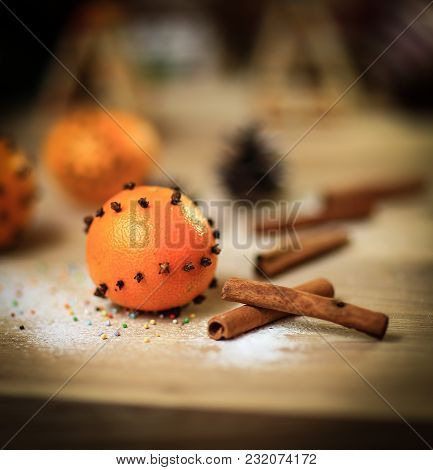 Christmas Table. Background Image Oranges And Cinnamon Sticks On A Wooden Table.photo With Copy Spac