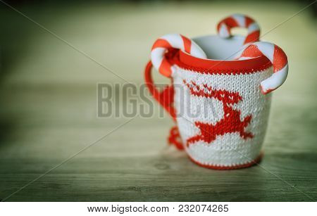 Christmas Mug And Candle On Wooden Background.photo With Copy Space