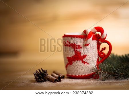 Christmas Mug With Decorations And Sweets On Wooden Background