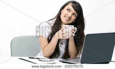 Closeup.young Woman With Cup Of Tea Sitting In The Workplace.isolated On White