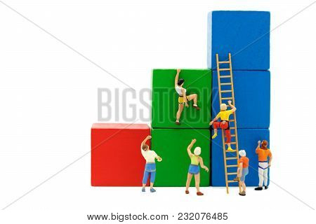 Miniature People: Climber Looking Up While Challenging Route On Growth Graph With Wood Ladder, Conce