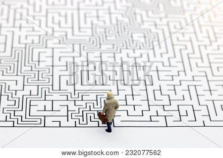 Miniature People: Businessman Standing On Start Of Maze. Concepts Of Finding A Solution, Problem Sol