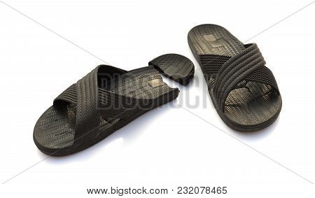 Pair Of Badly Worn Out Slippers On White