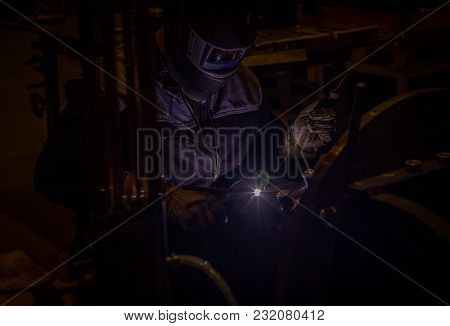 Welder At Orbital Welding Machine Intentionally Very Dark