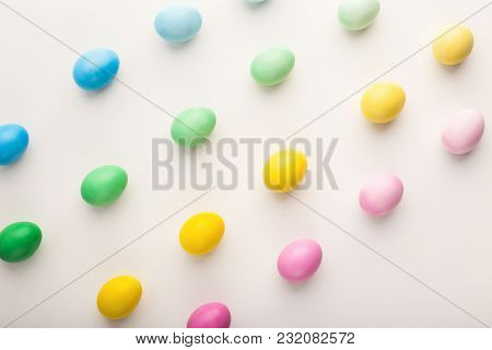 Gradient Colored Easter Chicken Eggs On White Isolated Background. Top View On Stylish Composition,