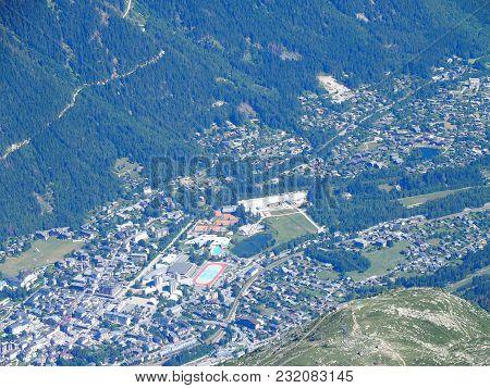 Chamonix Mont Blanc Village In Valley Seen From Aiguille Du Midi Peak At Highest Alpine Mountains Ra