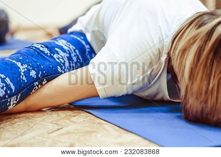 Beautiful Girl In Sportswear Is Doing Yoga On Yoga Mat In Sports Hall