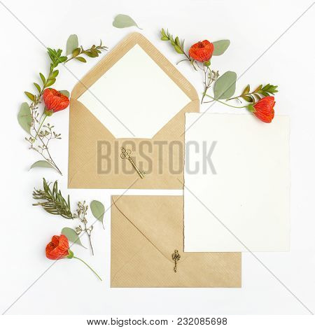 Flat Lay Shot Of Letter And Eco Paper Envelope On White Background. Wedding Invitation Cards Or Love