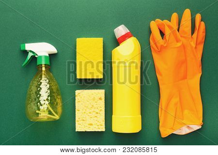 Spring Cleaning Background. Set Of Yellow Detergent Bottle, Sponges, Protective Gloves Isolated On G