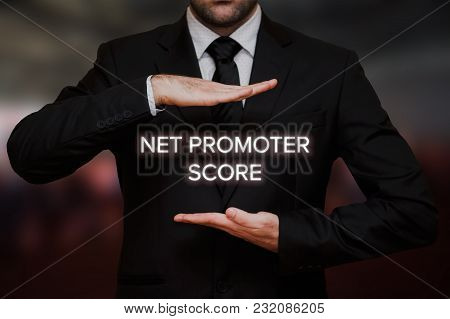 Net Promoter Score (nps) Concept Text Between Hands Of The Businessman, Blurry Bokeh Background