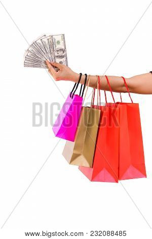 Woman Arm Carrying Colourful Shopping Bags With Dollar Money In Hand, Isolated, White Background