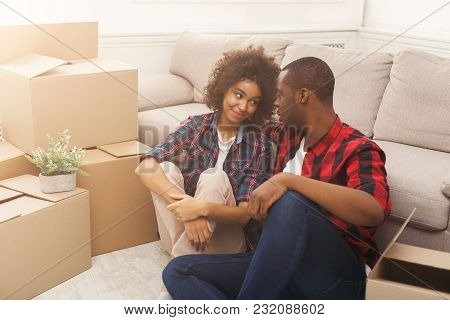 Happy African-american Couple Unpacking Moving Boxes In New Apartment, Copy Space